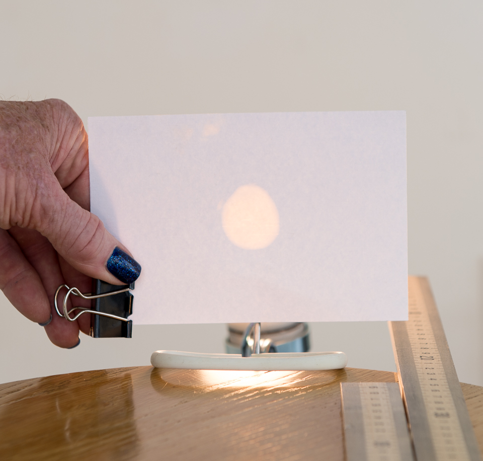 Science activity that demonstrates the brightness of two light sources
