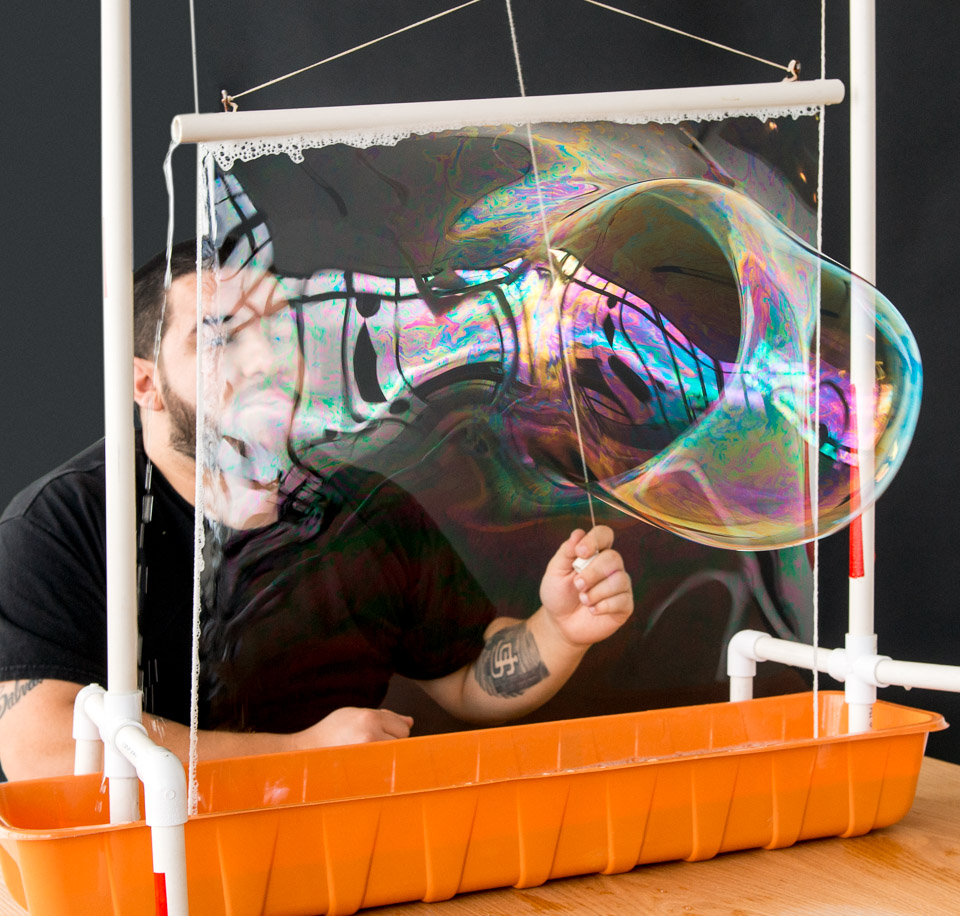Science activity that uses gravity to turn soap film into an ever-shifting array of colors
