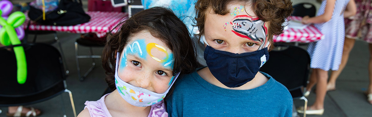 Two children after a facepainting activity.