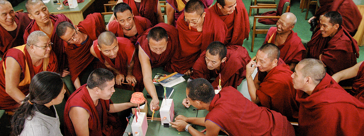 Tibetian monks learning how to make automata