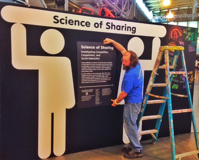 Science of Sharing team members hard at work during West Gallery installation. Hugh McDonald/Exploratorium