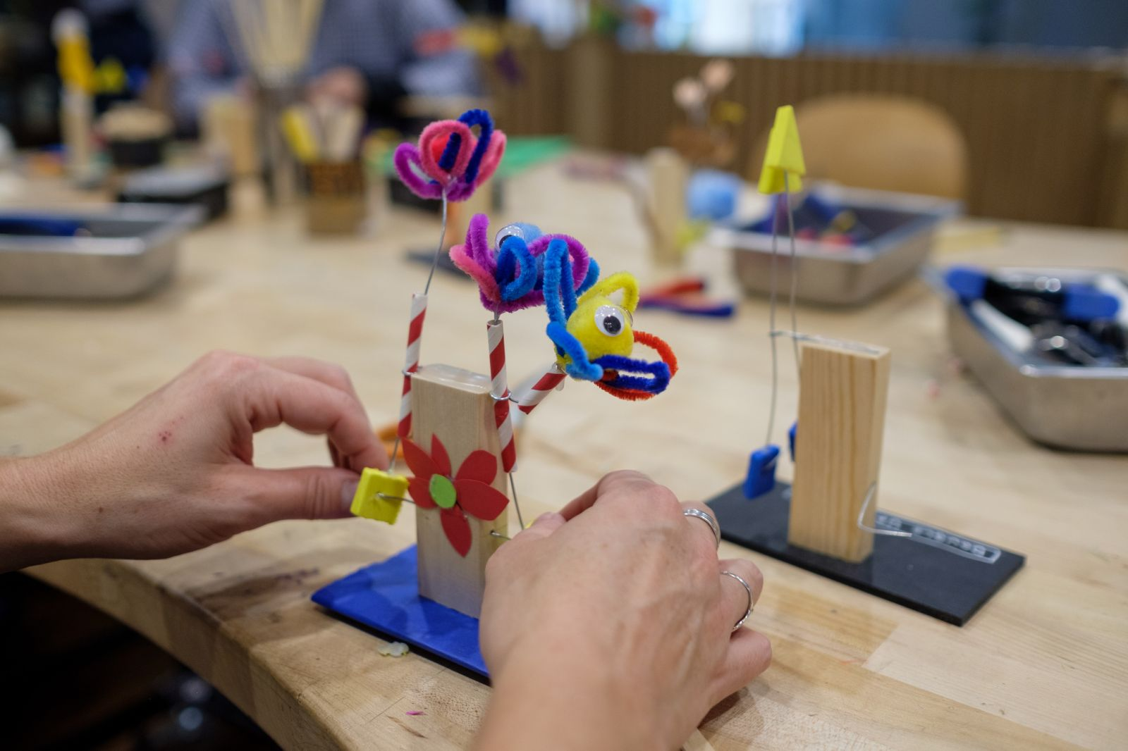 A flowers automaton made with pipe cleaners