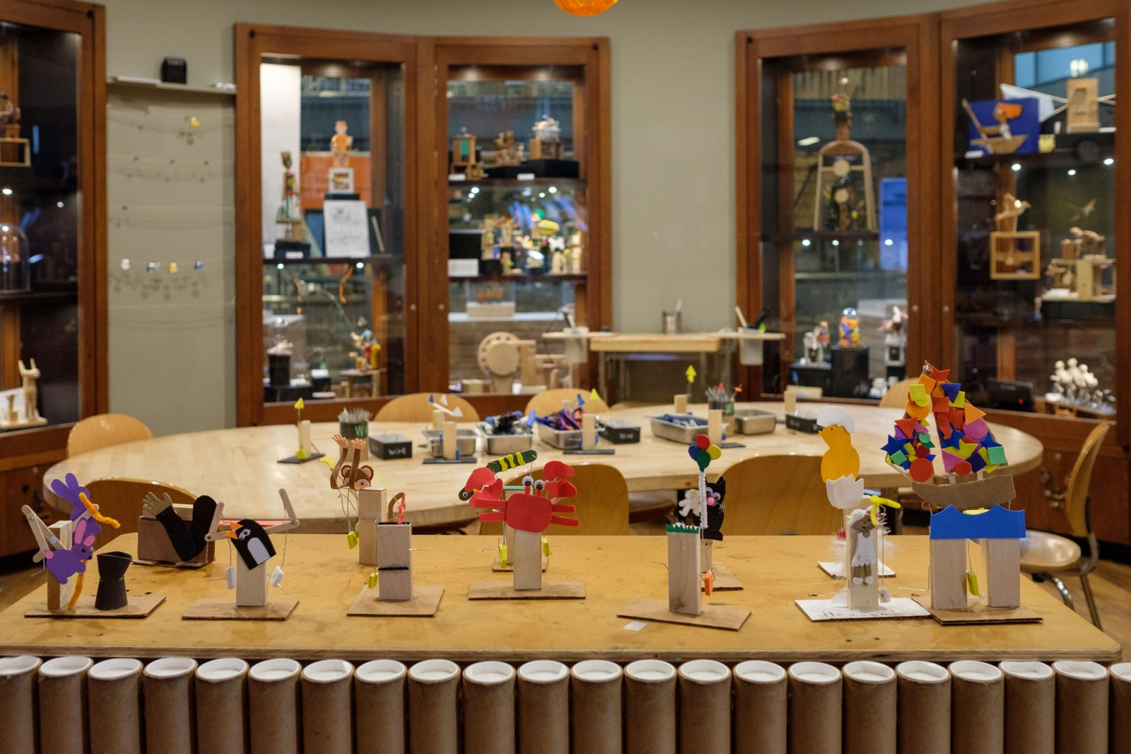 Cranky Contraptions examples set on a table in front of the Tinkering Studio