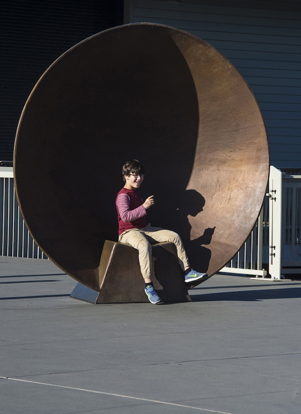 Sit in the giant parabolic sculpture to talk to your friends across the Exploratorium's plaza.