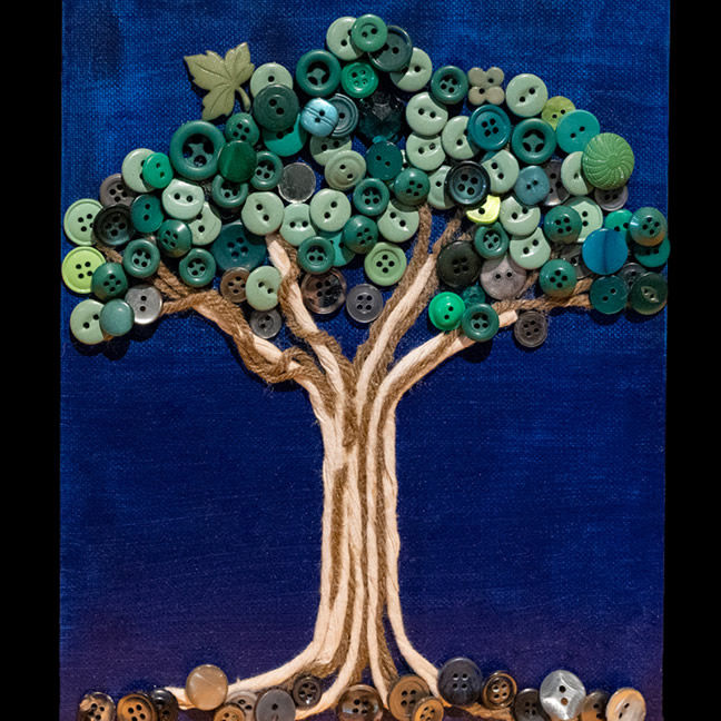 Tree made from buttons and yard