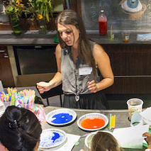 Volunteer teaching students about color