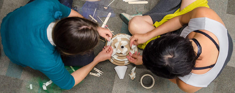 Building a marble machine together at a Tinkering Studio workshop