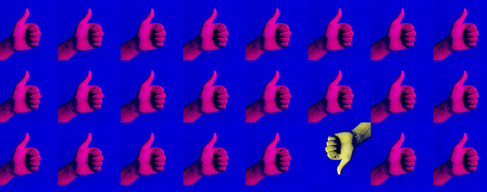 A blue background with a grid of hot pink hands making a thumbs-up symbol, and one yellow thumb making a thumbs-down symbol