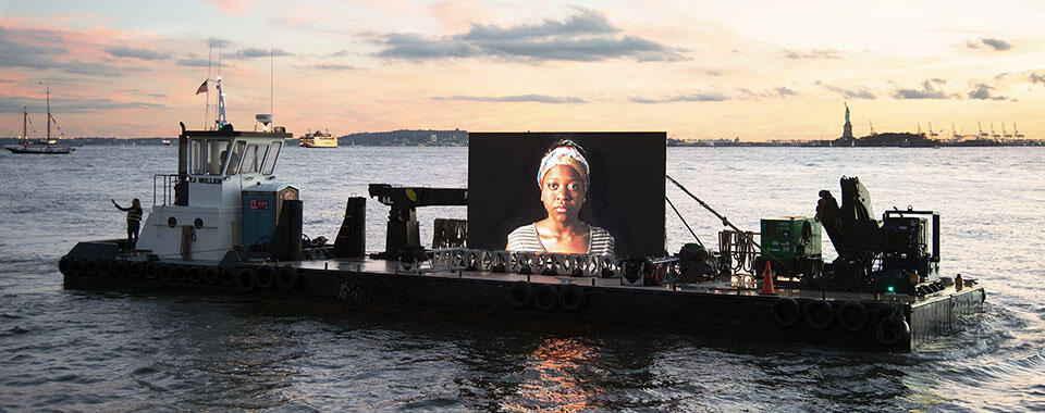 Night Watch video installation on a barge