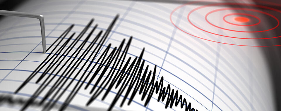 Photograph of a seismograph making a zigzag line during an earthquake