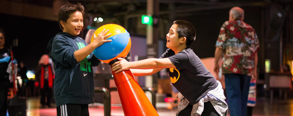Children playing with Bernoulli blower