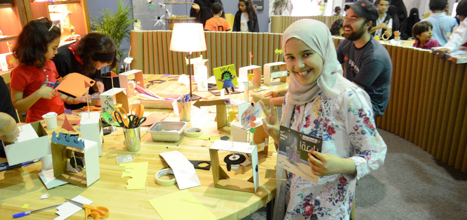 Children in Saudi Arabia enjoy making something at the Exploratorium's Tinkering Studio.