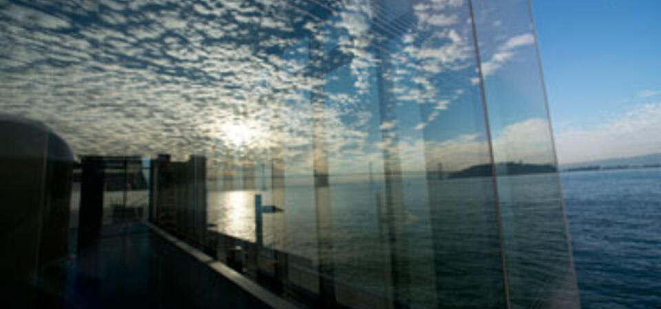 Reflection of clouds on glass walls of Exploratorium's new Fisher Bay Observatory Gallery. Image by Amy Snyder © Exploratorium, All rights reserved
