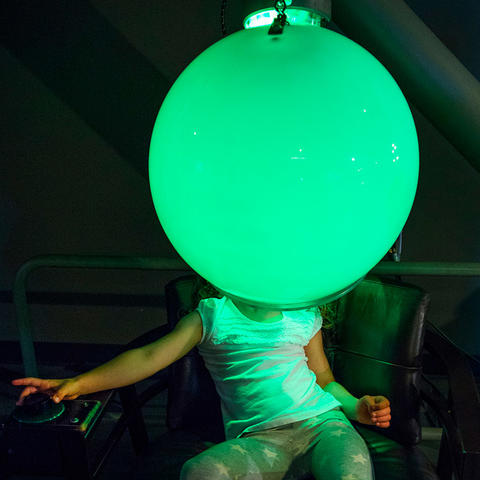 A visitor interacts with the Mood Lighting exhibit.