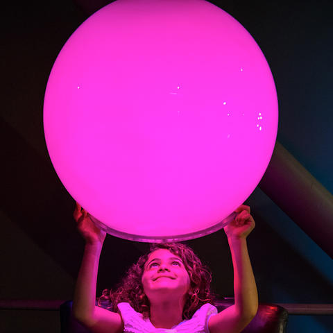 A Visitor Interacts With The Mood Lighting Exhibit