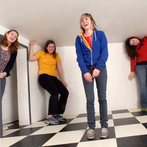 Visitors play inside the Distorted Room exhibit.