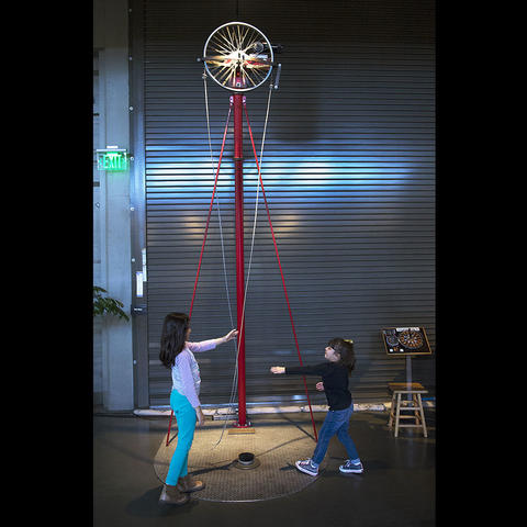 Visitors interact with the Lariat Chain exhibit