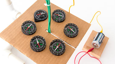 Science activity that demonstrates a magnetic field created by electromagnet