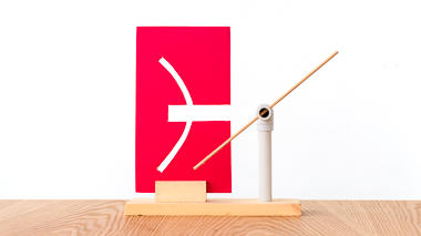 A science activity that demonstrates a straight rod passing through a curved slot