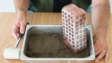 Science activity that models ground failure in a phenomenon called liquefaction