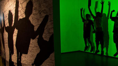 Visitors play inside the Shadowbox exhibit