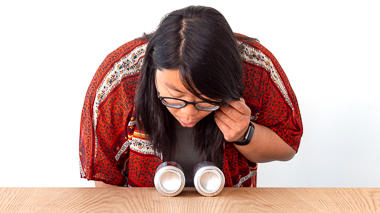 Science activity that demonstrates Bernoulli's principle by blowing between two empty cans
