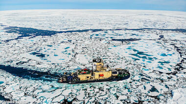 Swedish icebreaker Oden moving through Arctic ice floes.