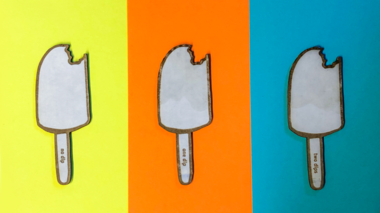 Three cardboard popsicles dipped varying times in an acrylic polyurethane coating.