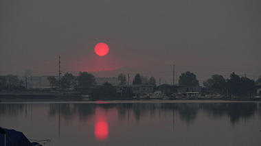 Smoky air creates vivid sunrise in the Bay Area.
