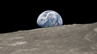 Iconic photo of Earth rising over the horizon of the moon.