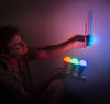 Science activity that demonstrates perception of additive color mixtures
