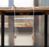 Science activity that demonstrates resonance in pendulums