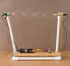 Science activity that investigates standing waves, nodes and antinodes.