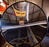 Science activity that explores infrared radiation through a parabolic mirror