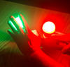 Science activity that demonstrates light and color mixing through a pinhole viewer