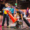 Two boys play with the Balancing Ball exhibit.