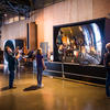 Visitors interact with the Giant Mirror exhibit.