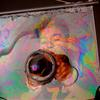 A visitor blows into the Soap Film Painting exhibit