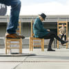 Exploratorium staff demonstrate forced perspective with the Big Chair/Little Chair exhibit.