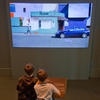 Young visitors interact with the Change Blindness exhibit