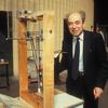 Exploratorium founder Frank Oppenheimer with an early version of the Coupled Pendulums exhibit.