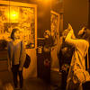 Visitors take a photo inside the Monochromatic Room.